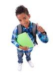 Λίγο αγόρι αφροαμερικάνων που αποτελεί τους αντίχειρες να υπογράψουν Στοκ Εικόνες