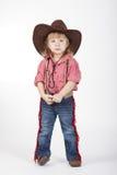 Λίγο αστείο cowgirl στο άσπρο υπόβαθρο Στοκ Εικόνες