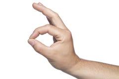 Λίγο κάτι, μια χειρονομία με το χέρι του σε ένα άσπρο backgroun στοκ εικόνες
