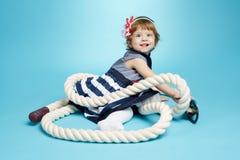 Λίγο μωρό ναυτικών στο μπλε Στοκ Φωτογραφία