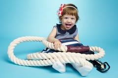 Λίγο μωρό ναυτικών στο μπλε Στοκ Εικόνες