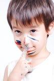Λίγο χαριτωμένο κατσίκι με τα χρώματα στο πρόσωπό του Στοκ Φωτογραφίες