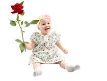 Λίγο χαριτωμένο κορίτσι παιδιών με το λουλούδι που απομονώνεται στο άσπρο υπόβαθρο Στοκ φωτογραφία με δικαίωμα ελεύθερης χρήσης