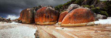 Λίθοι γρανίτη στη Squeaky παραλία στοκ εικόνες