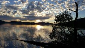 Λίμνη στο ηλιοβασίλεμα Στοκ Εικόνες