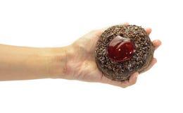Λαβή χεριών donuts Στοκ Φωτογραφίες