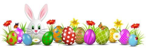 Λαγουδάκι Πάσχας με τα χρωματισμένα αυγά Πάσχας και τα λουλούδια που απομονώνονται - διάνυσμα Στοκ Εικόνα