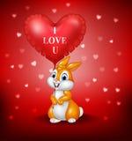 Λαγουδάκι κινούμενων σχεδίων που κρατά τα κόκκινα μπαλόνια καρδιών Στοκ Φωτογραφία