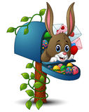 Λαγουδάκι Πάσχας με τα αυγά Πάσχας και την ταχυδρομική θυρίδα απεικόνιση αποθεμάτων