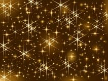 Λαμπρά χρυσά αστέρια, σπινθήρισμα Χριστουγέννων, έναστρος ουρανός Στοκ φωτογραφία με δικαίωμα ελεύθερης χρήσης