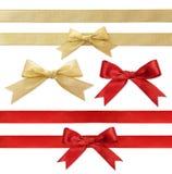 Λαμπρή κόκκινη και χρυσή κορδέλλα σατέν στο λευκό στοκ φωτογραφία με δικαίωμα ελεύθερης χρήσης