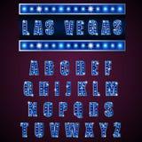 Λαμπτήρας αλφάβητων του ελαφριού νέου του μπλε στο μπλε υπόβαθρο Στοκ Εικόνες