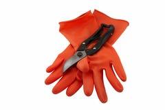 Λαστιχένιες γάντι και ψαλίδες Στοκ Φωτογραφίες