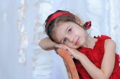 λατρευτό κόκκινο κοριτσιών φορεμάτων Στοκ φωτογραφίες με δικαίωμα ελεύθερης χρήσης