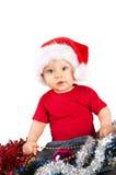 Λατρευτό παιδί Χριστουγέννων σε ένα κόκκινο καπέλο Στοκ εικόνες με δικαίωμα ελεύθερης χρήσης