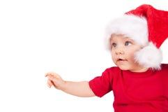 Λατρευτό παιδί Χριστουγέννων σε ένα κόκκινο καπέλο Στοκ Φωτογραφίες