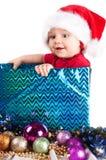 Λατρευτό παιδί Χριστουγέννων σε ένα κόκκινο καπέλο Στοκ Φωτογραφία