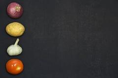 Λαχανικά στο σκοτεινό υπόβαθρο Στοκ Εικόνες
