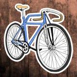 Λαϊκή αυτοκόλλητη ετικέττα τέχνης Χέρι που σύρει το αναδρομικό ποδήλατο διάνυσμα Στοκ Φωτογραφία