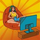 Λαϊκή τέχνη κοριτσιών gamer Ένα κορίτσι με την πολύχρωμη τρίχα κάθεται σε έναν υπνόσακο και ένα παίζοντας τηλεοπτικό παιχνίδι διά Ελεύθερη απεικόνιση δικαιώματος