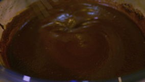 Λειώνοντας σοκολάτα με την κρέμα φιλμ μικρού μήκους