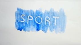 Λεκές χρωμάτων καλλιτεχνών watercolor επιγραφής αθλητικών κειμένων που απομονώνεται στο άσπρο βίντεο τέχνης υποβάθρου Στοκ εικόνα με δικαίωμα ελεύθερης χρήσης