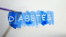 Λεκές χρωμάτων καλλιτεχνών watercolor επιγραφής κειμένων διαβήτη που απομονώνεται στο άσπρο βίντεο τέχνης υποβάθρου Στοκ Φωτογραφία