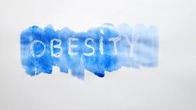 Λεκές χρωμάτων καλλιτεχνών watercolor επιγραφής κειμένων παχυσαρκίας που απομονώνεται στην άσπρη τέχνη υποβάθρου Στοκ Εικόνες