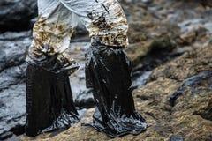 Λεκιασμένες πετρέλαιο πλαστικές μπότες Στοκ εικόνα με δικαίωμα ελεύθερης χρήσης