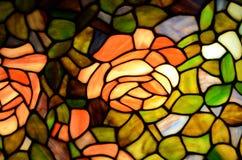 Λεκιασμένες τριαντάφυλλα και πρασινάδα γυαλιού Στοκ Φωτογραφίες