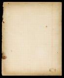 Λεκιασμένη παλαιά ευθυγραμμισμένη copybook σελίδα με τα περιθώρια Στοκ εικόνες με δικαίωμα ελεύθερης χρήσης