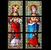 Λεκιασμένο γυαλί - η ιερή καρδιά του Ιησού και η καθαρότερη καρδιά χαλούν Στοκ φωτογραφία με δικαίωμα ελεύθερης χρήσης