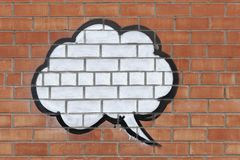 Λεκτική φυσαλίδα στον τοίχο των κόκκινων τούβλων Στοκ εικόνες με δικαίωμα ελεύθερης χρήσης