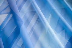 Λεπτές διαφανείς μπλε κουρτίνες σφραγίδων Στοκ φωτογραφία με δικαίωμα ελεύθερης χρήσης