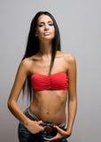 Λεπτή ομορφιά brunette. Στοκ Φωτογραφίες