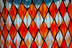 Λεπτομέρεια λεκιασμένου του πορτοκάλι γυαλιού Στοκ Φωτογραφίες