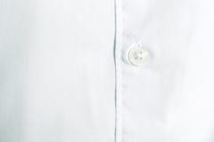 Λεπτομέρεια κουμπιών πουκάμισων λευκό υφάσματος βαμβακ&i Στοκ φωτογραφία με δικαίωμα ελεύθερης χρήσης