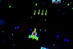 Λεπτομέρεια σε ένα διαστημικό σκάφος πυροβολισμού ενός παλαιού τηλεοπτικού παιχνιδιού arcade Στοκ Εικόνα
