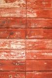 Λεπτομέρεια της κόκκινης ξύλινης πόρτας Στοκ Εικόνα