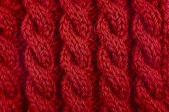 Λεπτομέρεια της κόκκινης πλέκοντας βελονιάς καλωδίων Στοκ Φωτογραφία