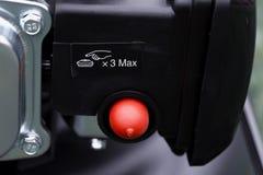 Λεπτομέρεια του κουμπιού έμφραξης μιας μηχανής θεριστών στοκ φωτογραφίες