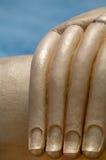 Λεπτομέρεια χεριών του μεγάλου Βούδα Στοκ Φωτογραφία