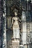 Λεπτομέρειες ενός τοίχου σε έναν παλαιό ναό σε Angkor Wat Στοκ Εικόνες