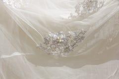 Λεπτομέρειες του υφάσματος φορεμάτων νυφών και του όμορφου weddi κεντητικής Στοκ εικόνες με δικαίωμα ελεύθερης χρήσης