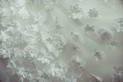 Λεπτομέρειες του υφάσματος φορεμάτων νυφών και του όμορφου weddi κεντητικής Στοκ εικόνα με δικαίωμα ελεύθερης χρήσης
