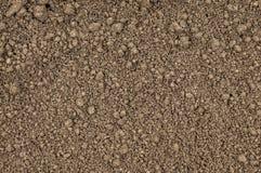 Λεπτομερής έδαφος σύσταση, καφετί υπόβαθρο καλλιεργήσιμο γήινο καλό έδαφος ανασκόπησης που οργώνεται Στοκ Φωτογραφίες