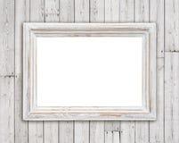 Λευκαμένο ξύλινο πλαίσιο εικόνων στο εκλεκτής ποιότητας υπόβαθρο τοίχων σανίδων Στοκ Φωτογραφίες