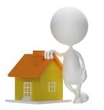 Λευκός χαρακτήρας με το σπίτι στοκ φωτογραφία με δικαίωμα ελεύθερης χρήσης