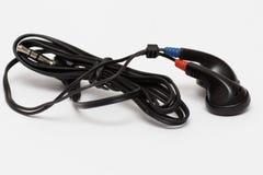 λευκό ανασκόπησης earbuds Στοκ Εικόνες