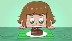 Λευκό κορίτσι που εξετάζει τη φέτα κέικ Στοκ Εικόνα